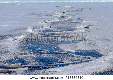 sea ice close up in the winter - stock photo