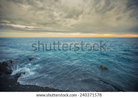 sea in a cloudy day - stock photo