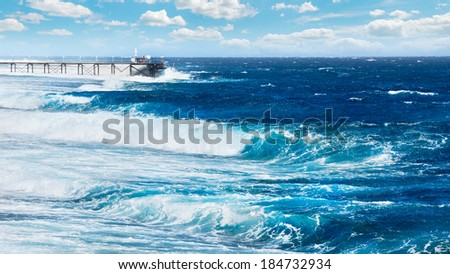 Sea ??in a storm hits the dock - stock photo