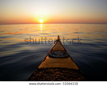 sea kayak and sunset - stock photo
