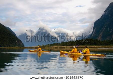 sea kayak in Milford Sound, New Zealand - stock photo