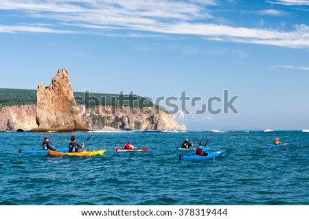 Sea kayaking along the coast of the Pacific Ocean, Kamchatka - stock photo