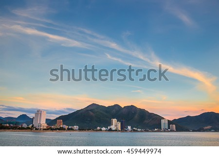 Sea landscape. Evening on the stone beach. Sunset on a tropical beach in Asia.