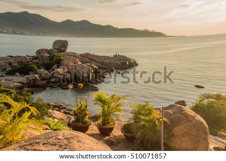 Sea landscape. Evening on the stone beach.Vietnam, Nha Trang. Sunrise on the beach. Sunset.