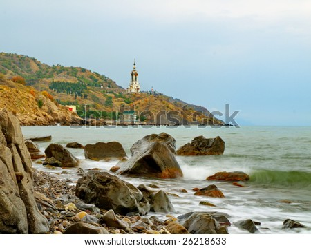 Sea landscape with a lighthouse and church