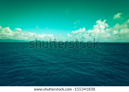 Sea landscape with blue sky and clouds. Traveling background in vintage style