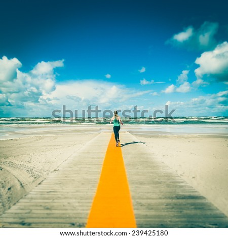 Sea landscape with sportive girl running to the sea. Selective focus. Instagram style. - stock photo