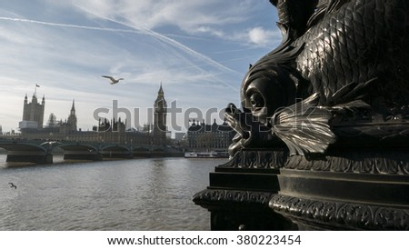 Sea monster architectural detail is threatening to eat the Houses Of Parliament in London. - stock photo