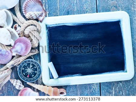 Sea objects - shells, sea stars on wooden planks - stock photo