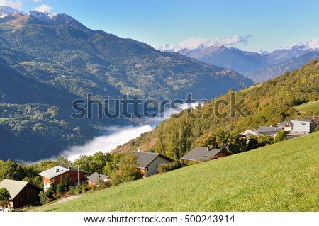 sea of clouds in a valley of a mountain
