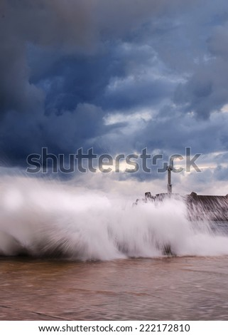 Sea on a stormy day. lighthouse.long exposure was used to capture the image. - stock photo