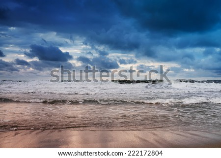 Sea on a stormy day.long exposure was used to capture the image. - stock photo