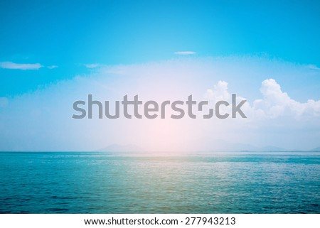 sea on day noon with blue sky, light effect.