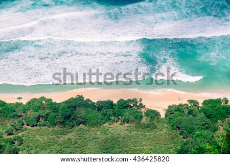 Sea. Paradise view above the sea. Idyllic aerial view of empty tropical beach, vivid blue sea, white foam waves in Bali. Above the sea. Sea view in Bali. Aerial view of sea waves near beach. Sea view. - stock photo