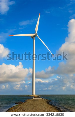 Sea path leading to Danish wind turbine, sky background