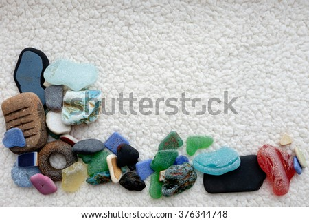 sea pebble glass on cloth in the corner along one side
