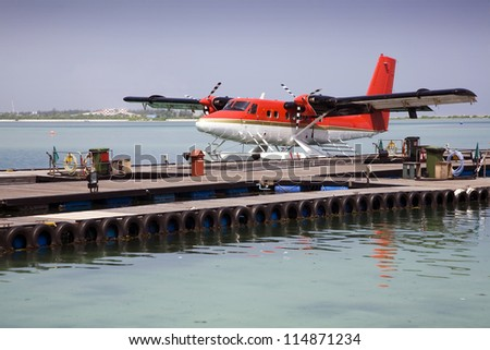 Sea plane moored at the docks awaiting passengers. - stock photo