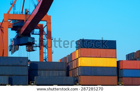 Sea port, cargo ships and container yard - industrial structure for import and export of freight. Shipping and logistic terminal of the global business. - stock photo