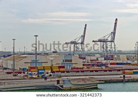 Sea port with loading cranes and containers