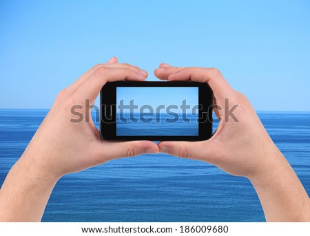 Sea reflection on screen. Cell phone. Whole background. - stock photo
