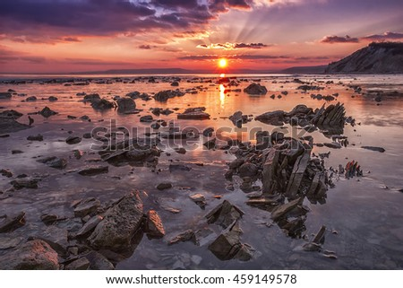 Sea rocks at sunset. Exciting sunset view at the Black sea coast, Bulgaria - stock photo