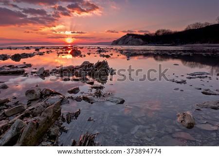 Sea rocks at sunset. Magnificent sunset view at the Black sea coast, Bulgaria - stock photo