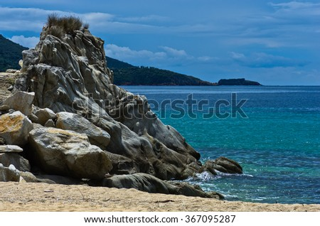 Sea rocks on a sandy beach at early morning, west coast of peninsula Sithonia, Chalkidiki, Greece