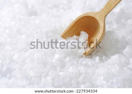Sea salt and wooden scoop - stock photo