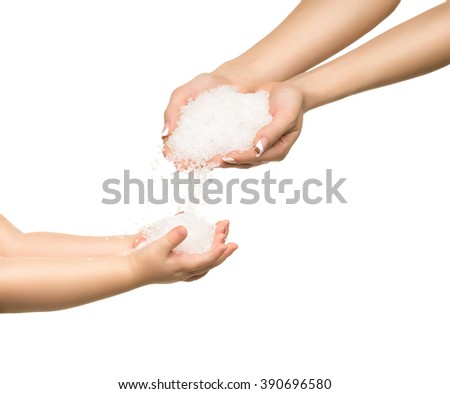Sea salt crystals in women hand and child hand. - stock photo