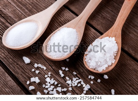 sea salt different grinding in a wooden spoons - stock photo