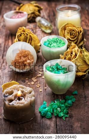 sea salt for Spa treatments with ceramic cups on the background of the buds dried yellow roses - stock photo