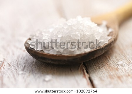 sea salt in a wooden spoon - stock photo