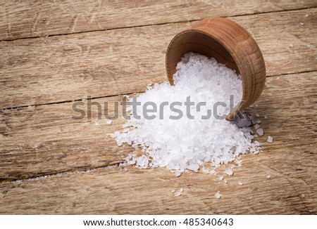 sea salt in bowl on wooden background