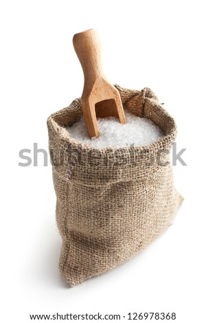 sea salt in jute sack on white background - stock photo