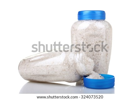 sea salt in the bottle on white isolated background - stock photo