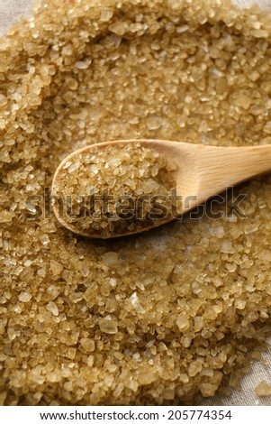 Sea salt in wooden spoon, close up