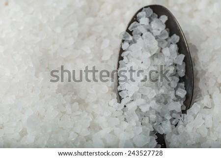 Sea salt on a spoon - stock photo