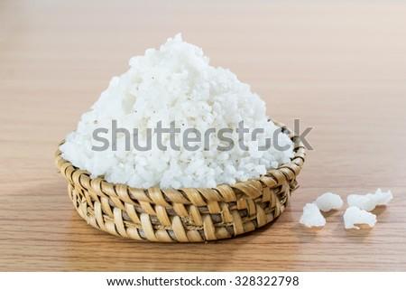Sea salt on bamboo wickerwork - stock photo
