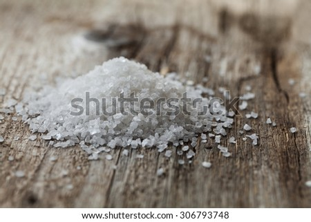 Sea salt on rustic wooden background