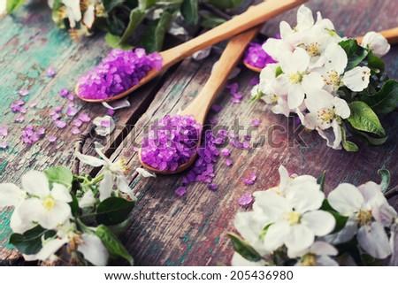 Sea salt  on vintage wooden background. Selective focus, horizontal. - stock photo