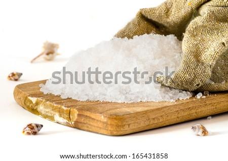Sea Salt on white background - stock photo