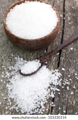sea salt on wooden table - stock photo