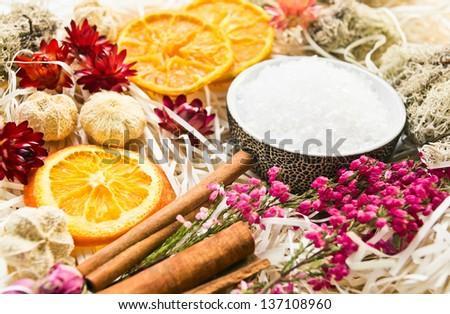 Sea salt with dried fruits, plants and flowers - stock photo