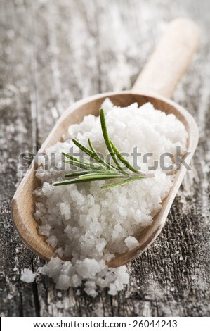 sea salt with rosemary on a wooden spoon - stock photo