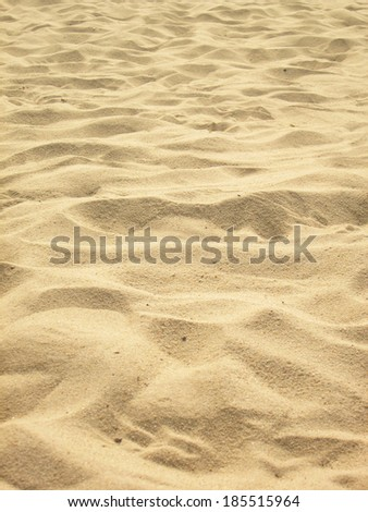 sea sand with footprints (series) - stock photo