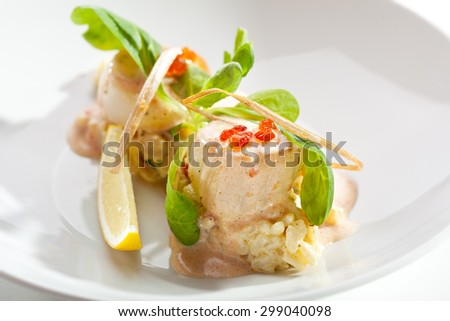 Sea Scallop with Risotto and Sauce - stock photo