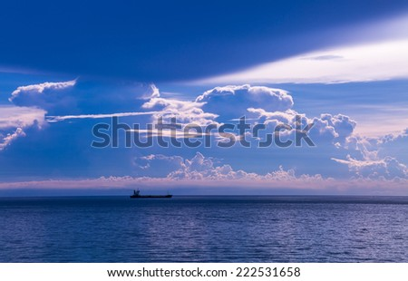 Sea scape under cloudy sky in twilight time - stock photo