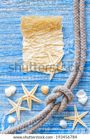 Sea shells and old paper - stock photo