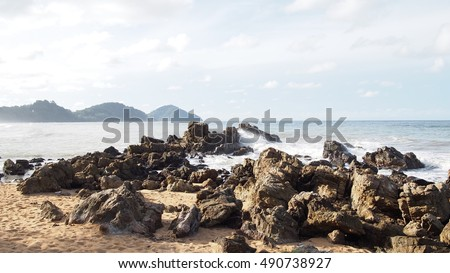 Sea shore and a rock in the morning.