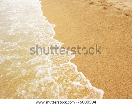 Sea shore, foamy water at Costa Brava(Spain) - stock photo